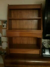 Book shelf or small childs desk. Has a drawer and shelves .