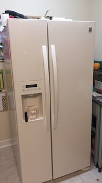 Off-white side-by-side refrigerator with dispenser