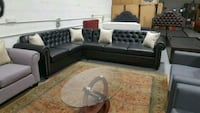 black leather sectional couch with throw pillows Calgary, T3J 0C3