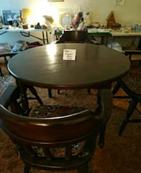 round brown wooden table with four chairs dining s Thorold, L2V 1W5