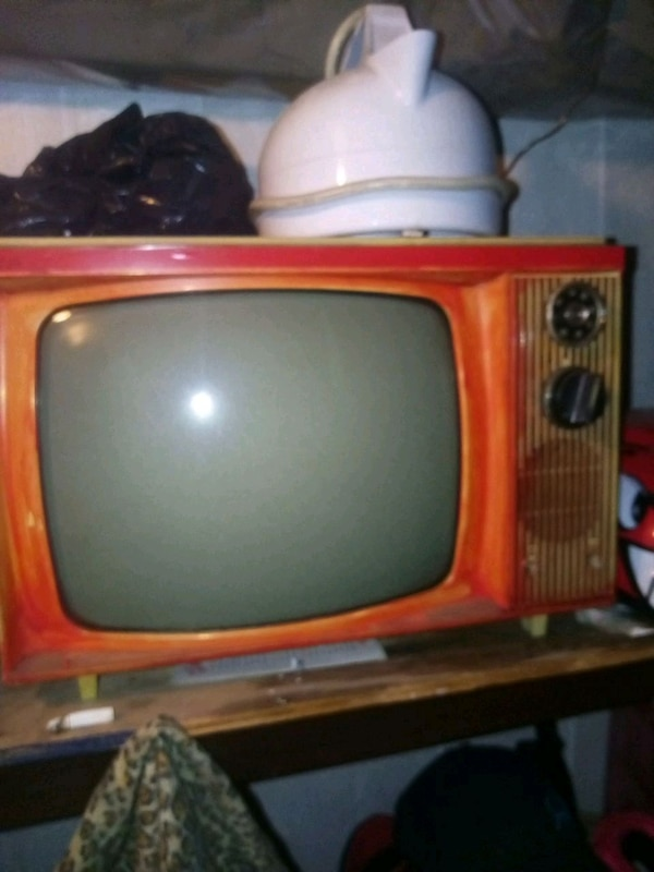 red and black CRT TV