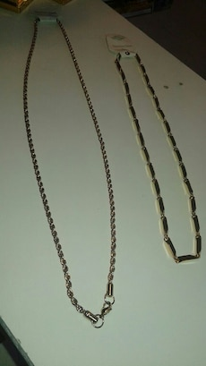 two silver necklaces