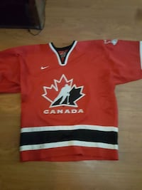 red and white Nike Canad ice hockey jersey Surrey, V3T 1Z3