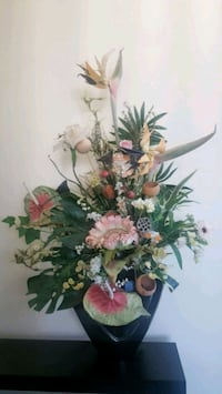 Silk flower arrangement decoration in black vase