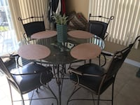 Round glass top table with four chairs dining set Port Hope, L1A