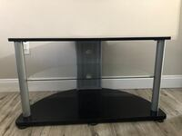 Black wooden frame glass top tv stand Kissimmee, 34743