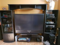 black JVC flat screen TV with black wooden entertainment system center