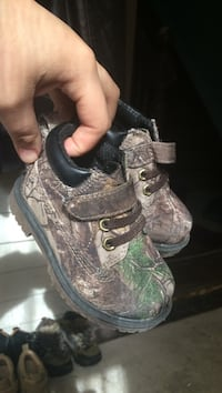 Pair of toddler's brown-and-beige camouflage leather boots Winnipeg, R2W 1K9