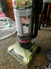 white and green Hoover upright vacuum cleaner 612 mi