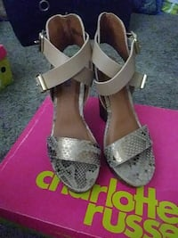 women's pair of gray snakeskin leather pumps