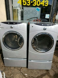 two white front load washing machines Peoria, 61602