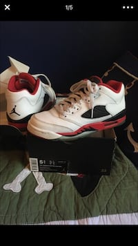 Pair of white-and-red Air Jordan 5 retro low shoes on box  size 5.5