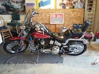 red and black cruiser motorcycle