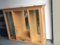 China cabinet with lighting and storage (top & bottom pieces shown separately). Glass shelves not shown