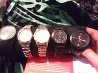 five assorted analog watches