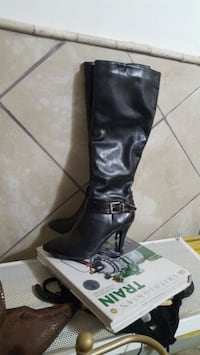 pair of black leather knee-high boots Calgary, T2J 0E3
