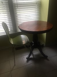 round brown wooden pedestal table with two chairs Springfield, 22152