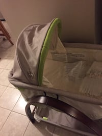 baby's gray and green bassinet