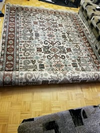 brown and black floral area rug Toronto, M9V 3T1
