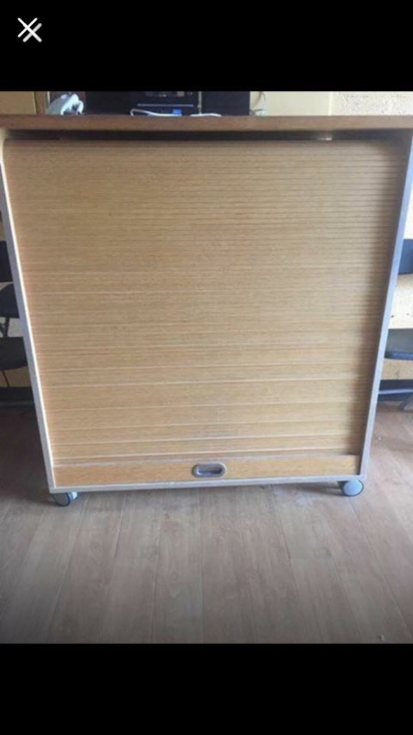 Wood storage cabinet on wheels 46 wide by 44 high by 24 deep and has 2 shelves. Too can be used as podium for meetings (if yeuse for office) and