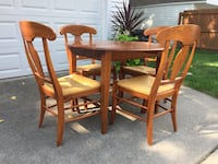 Ethan Allen solid cherry wood table with 4 chairs. In great condition and table was originally $1,250 and the chairs $350. Great deal!