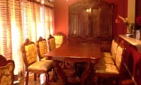 Solid Harwood Dining set.Comes with China and 10 chairs with two extension leaves of table. ASHBURN