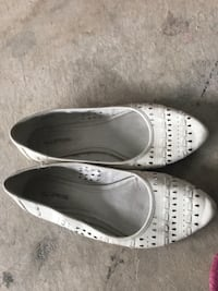 pair of white leather slip-on shoes Surrey