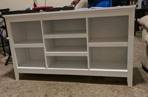 New Horizontal Bookcase/Shelf- has a ding on one side