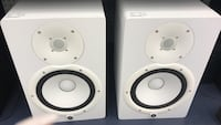 two white PA speakers