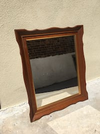 "Wood frame mirror by Turner 21"" by 25"" Wood has minor scratches on one side New York, 11377"