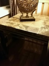 Stone end table 29in square 25 high. Great conditi