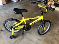 Yellow and black bmx bike