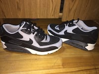 Pair of black-and-white nike sneakers Montréal, H4L 1A2
