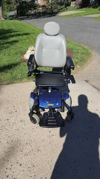 blue and black motorized wheelchair 33 km