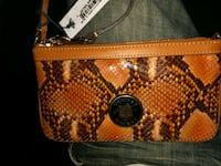 Dooney & Bourke wristlet (Brand new) 1921 mi
