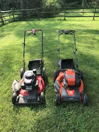 two red and black push mowers HERNDON