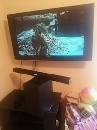 black flat screen TV with stand Cookeville, 38501