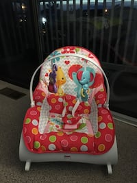 Baby's pink and white Fisher-Price bouncer