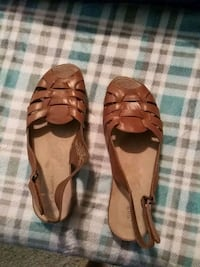 pair of brown leather flat sandals Biloxi, 39531