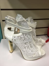 pair of white lace-up wedge shoes Hamilton, L9A 4H9