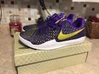 pair of purple-and-black Nike running shoes with box