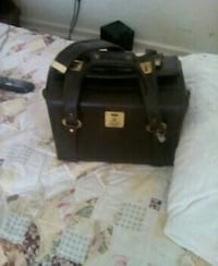 Small suitcase comes with key. Seven Corners, 22044