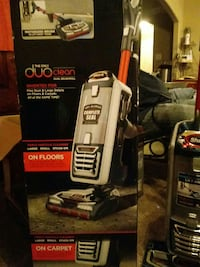 black and gray Shark upright vacuum cleaner box
