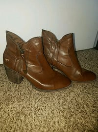 pair of brown leather round-toe chunky heel booties