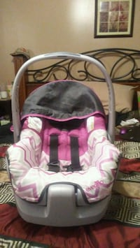 baby's pink and white car seat carrier 669 mi