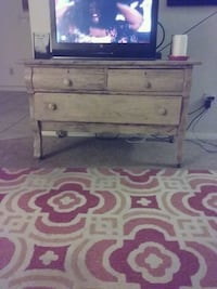 black flat screen monitor with brown wooden TV stand Rogers, 72758