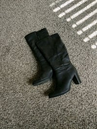 pair of black leather boots 1407 mi