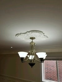 white uplight chandelier with gray