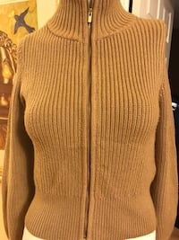 brown knitted zip-up turtle sweater