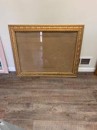 Gold metal picture frame with glass
